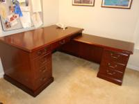 Executive desk, right hand L-shape. 2 file drawers, 3