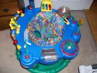 Exersaucer. It's in pretty good condition. It could use