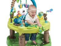 Evenflo exersaucer with amazon/animal theme. Child can