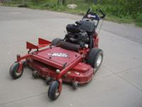 "Exmark Turf Tracer 52"" Walk Behind that has 1059 hours"