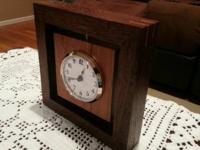This clock is custom made in a  contemporary style.