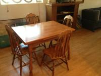 Very nice oak table and matching chairs.  Measures 42 x