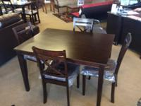 I have a Brand New - Beautiful Dining/Dinette set that