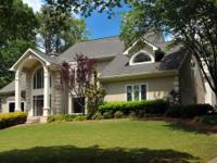 This exquisite custom home is situated on the corner of