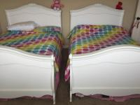 Two full sleigh beds, perfect for a kid's room. No