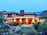 Dramatic setting in guard-gated Stone Canyon nestled