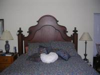 This solid cherry bed made by Lexington is in pristine
