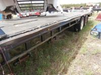 Extendable stretch flatbed semi trailer. It is ugly,