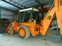 JCB BACKHOE WITH ENCLOSED CAB/4 CYLINDER PERKINS TURBO