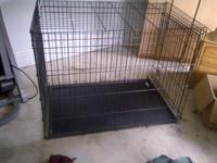 Extra large dog crate for immediate sale. Call Michele