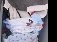 Extra large sized tote full of baby boy clothes. Sizes