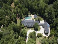 Gated waterfront property on five acres with the most