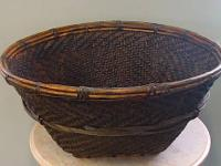 This extra large antique storage basket is tightly