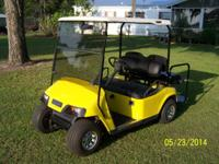 This is a beautiful EZ GO golf cart that has new