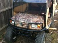 Ez-Go Camo sport ST golf cart. Runs great. Lifted with
