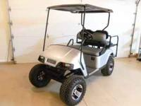 EZ GO GAS GOLF CART WITH LIFT KIT, NEW SILVER BODY, NEW