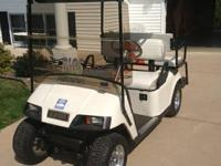This is a very nice Gas golf cart thats been customized