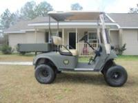 EZ Go golf cart, lifted with after market rims covered