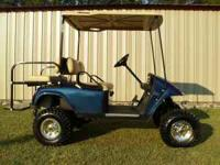 "EZ-GO TXT WITH GAS ENGINE, 6"" LIFT,22"" TIRES,10"" RIMS,"