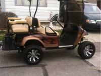 99 ezgo with custom paint, lift kit, wheels and tires,