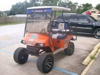 Go Gators themed golf cart is waiting for you! Be the