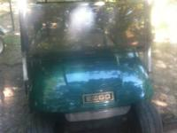 EZGO golf cart that has brand-new batteries. It has