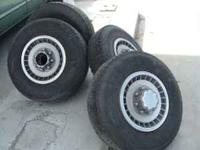 Four tires LT235/85/16 approx 50% tread mounted on