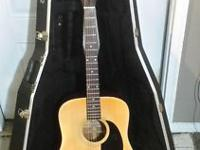 This is a 35 year old acoustic guitar made by Fender.