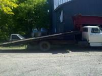 1972 Ford F600 Rollback. 21' steel bed, pto winch, V8,