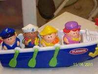 Fisher Price Little People Boat with 4 men. Has music
