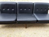 Fabulous Mid Century Sofa with black vinyl cushions and