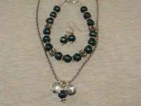 New, hand made, three piece set with sterling silver