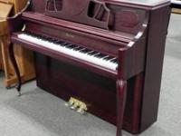 Beautiful Mahogany satin finish Falcone console piano.