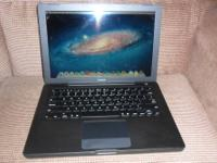This is a Factory refurbished Black Macbook. It has New