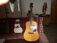 this guitar plays fine low action in good condition new