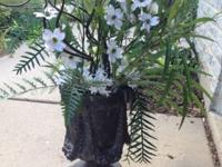 Fake flowers stands about 1 1/2ft tall with flowers the