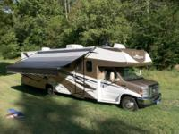2009 Coachmen Leprechaun 320DS with 2 slides and 28000