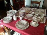 8 place settings plus 4 extra dinner plates and 4 extra