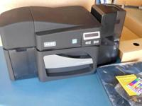This is a new, never used Fargo DTC 4500e printer. Has
