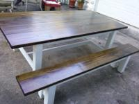 Beautiful farmhouse table and benches. They have a dark