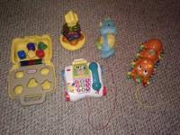 Group 1) Toy phone, light up sea horse, pull ABC