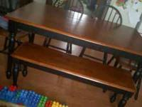 . The table is newer has 4 chairs and bench. The wall
