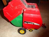 Metal New Holland Bailer 15.00 obo email or text me at