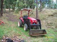 This is a 2005 Jinma 35-hp farm tractor, with front