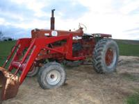 Farmall 806 with International Front End Loader. -New
