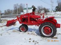 Herew is a Farmall BN with a loader. New Motor. All new
