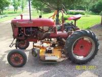 "1948 Farmall Cub with 60"" Woods mower. Runs goods. Left"
