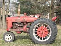 farmall m sitting about a year kept stored inside needs
