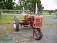 Farmall super c runs great, cultivators,plow $2000.00