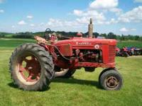 1. Farmall Super M with live hydraulics. Good